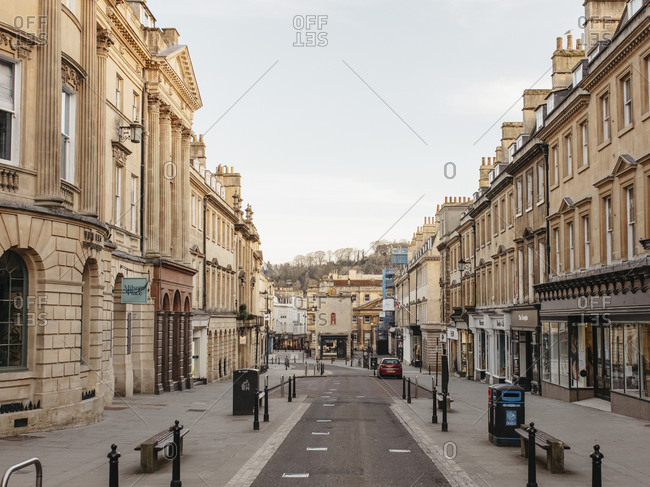 Buildings along empty main street, Bath, Somerset, UK