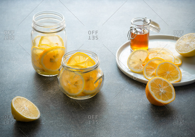 Lemon slices in jars with honey on the side