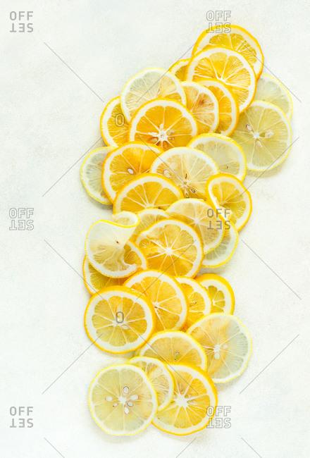 Lemon slices on light background top view