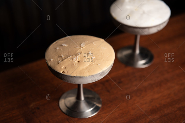 Two ice cream servings in stainless steel dish