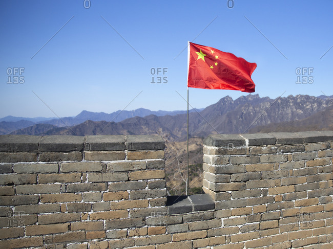 Flag on the Great Wall of China near Mutianyu District outside Beijing, China