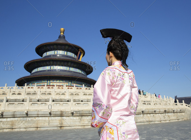 Young lady in period costume in front of the Temple of Heaven at the Forbidden City Palace, Beijing, China