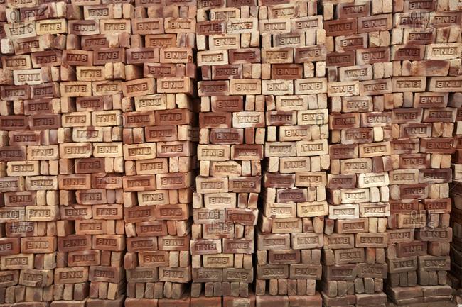 Chittagong, Bangladesh - May 12, 2013: Large stacks of bricks in a brick factory