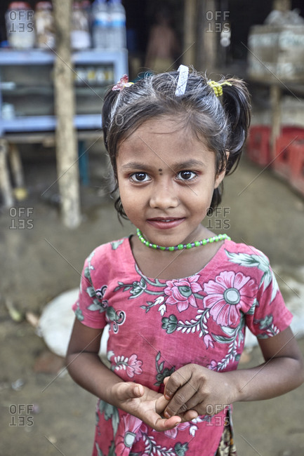 Bandarban, Bangladesh - May 7, 2013: Portrait of a little girl in the Marma Tribe in the highland valleys of Chittagong Hill Tracts