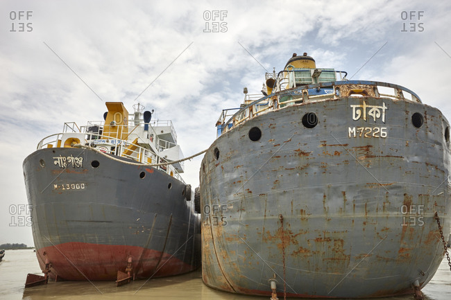 Chittagong, Bangladesh - May 12, 2013: Large ships anchored on the shores of the Bangla Bazar Ghat of the River Karnaphuli in Chattogram