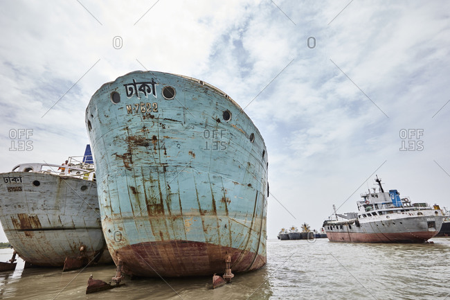 Chittagong, Bangladesh - May 12, 2013: Old ships anchored on the shores of the Bangla Bazar Ghat of the River Karnaphuli in Chattogram
