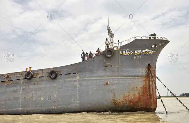 Chittagong, Bangladesh - May 12, 2013: Men on the deck of a large ship anchored at the Bangla Bazar Ghat of the River Karnaphuli in Chattogram