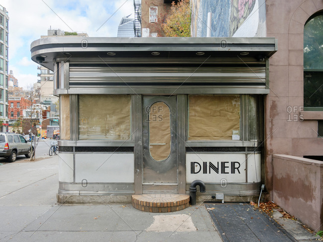 New York City, New York - October 28, 2016: A typical diner restaurant facade in vacant condition in the Chelsea neighborhood in Manhattan