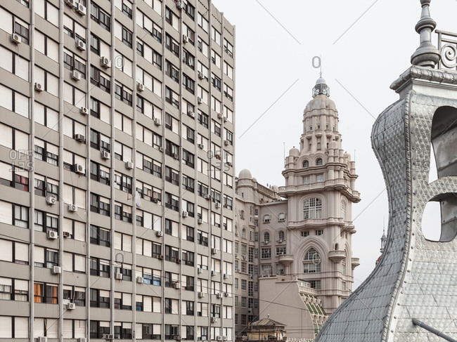 Buenos Aires, Argentina - July 22, 2019: View of Palacio Barolo on Avenida de Mayo with a modernist building on the left and Hotel Chile's dome partial view on the right