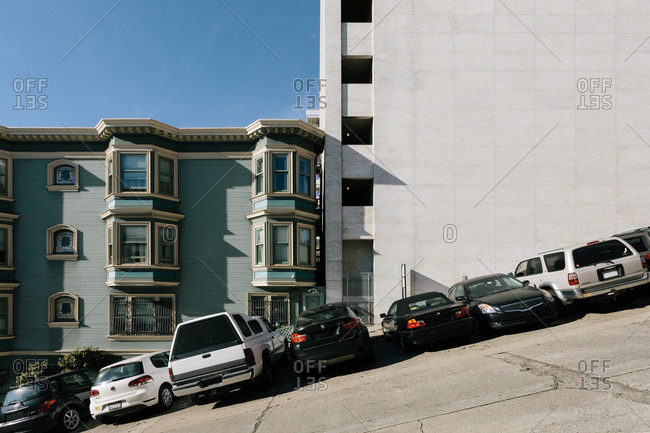 San Francisco, California - December 20, 2016: A view of a typical steep street with a clash of characteristic Victorian architecture and contemporary buildings