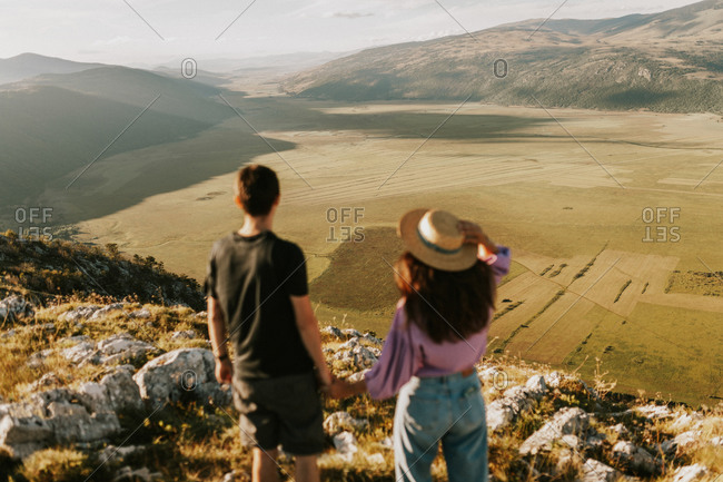 Couple overlooking beautiful mountain landscape in Bosnia and Herzegovina