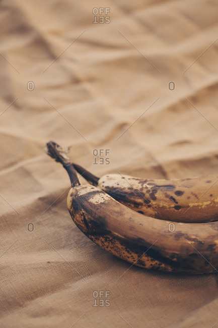 Closeup of bunches of bananas placed on brown linen napkin