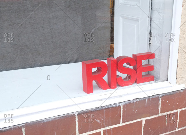 Red Rise sign on windowsill