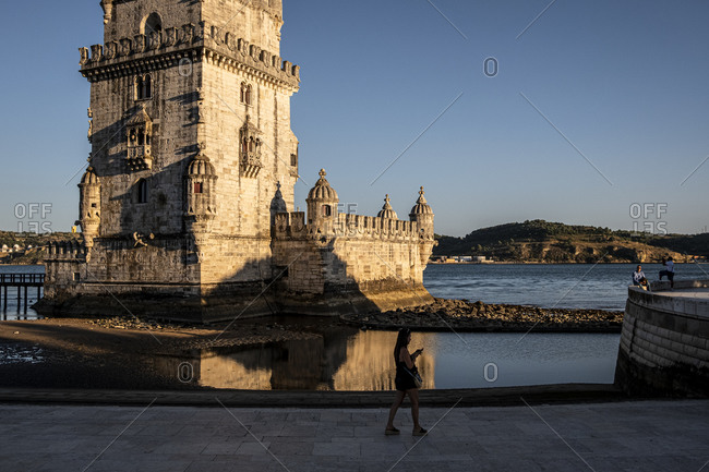 Lisbon, Portugal - August 1, 2020 : Woman walking Belem Tower