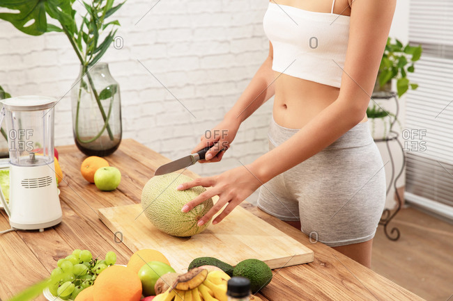Healthy woman eating delicious fruit