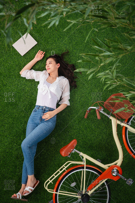 Young woman lying on the grass and enjoying nature