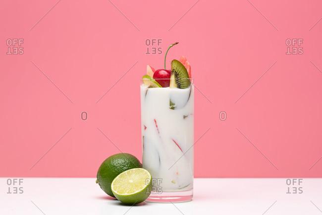 Fruit yogurt cup and lime