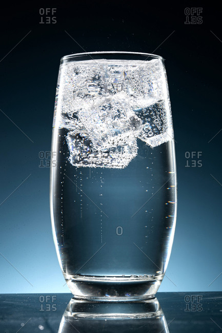 Cold sparkling drink with ice