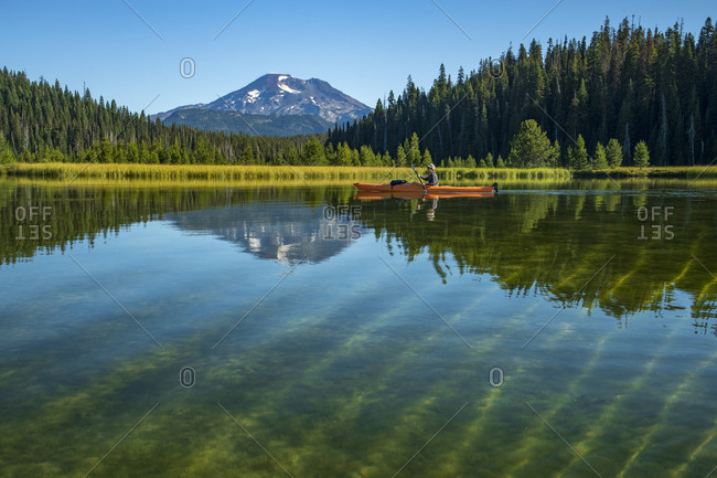 Bend, OR, United States - August 20, 2020: Kayak with South Sister Oregon