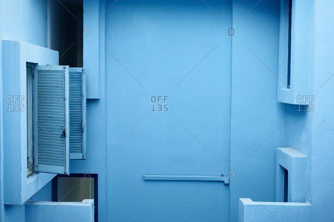 "Calp, Valencian Community, Spain - August 6, 2020: Blue building inside the ""Muralla Roja"" in Calpe, Spain"