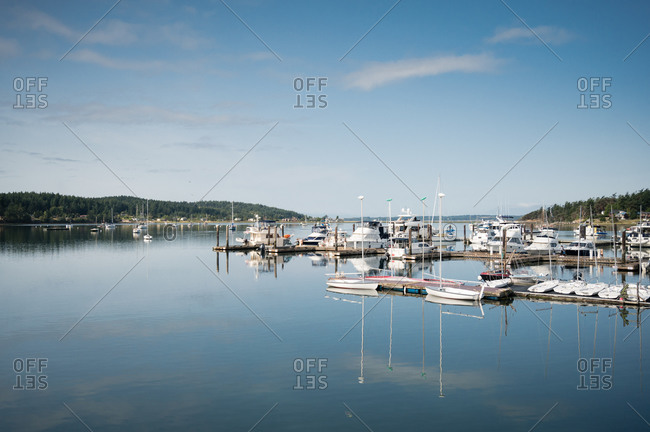 Sailboats reflected in the water on a peaceful, sunny day on Lopez Island, WA