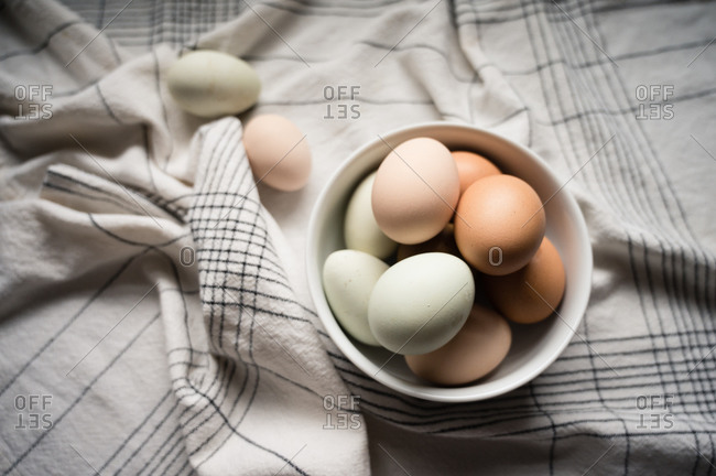 Eggs Nestled in White Bowl on Table at Home