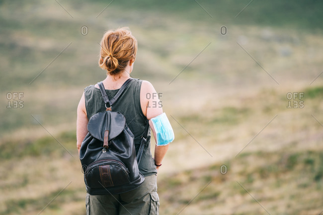 Back traveler woman with medical face mask