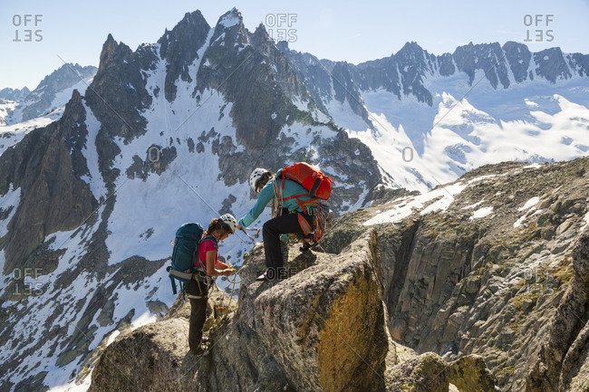Women rappel from climbing on Lochberg, Furka Pass, Uri, Switzerland
