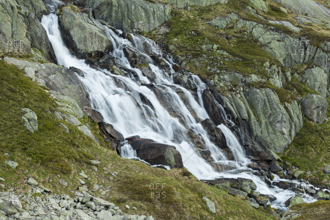 Waterfall of Lochbergbach river above Realp, Uri, Switzerland