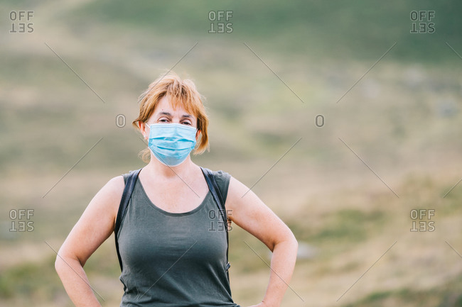 Traveling woman putting a medical face mask on her face