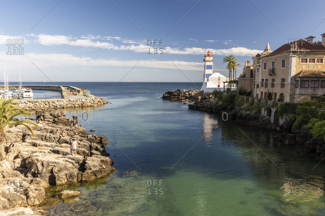 Cascais, Lisbon, Portugal - August 9, 2020: Beautiful view to ocean front lighthouse in Cascais