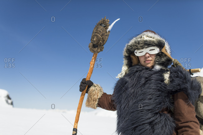 Native American hunter dressed in Traditional Fur clothing.