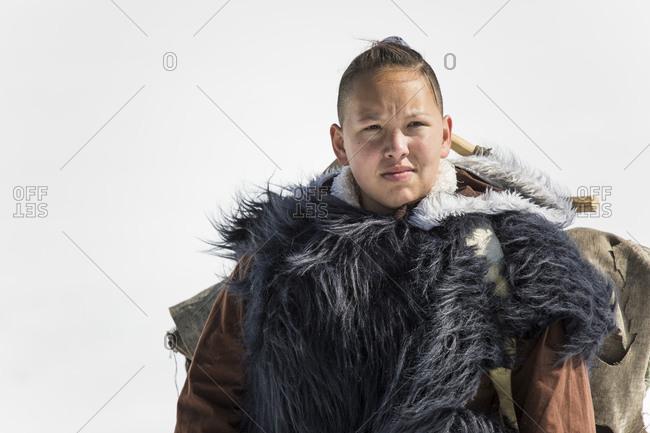 Portrait of Aboriginal woman dressed in fur clothing.