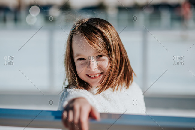 Portrait of a young girl outside on a sunny winter day