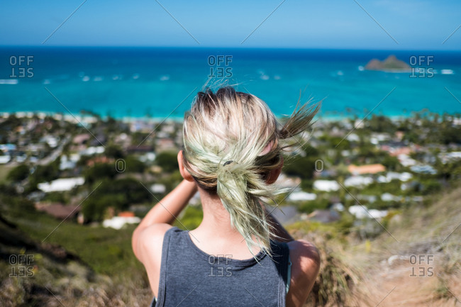 Girl staring at the ocean on a pill box bunker in Hawaii