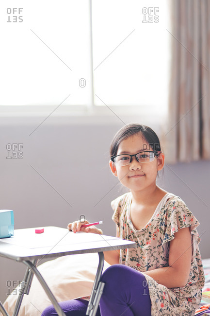 Portrait of girl with her table of homework
