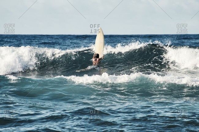 Man Surfing With A Yellow surfboard