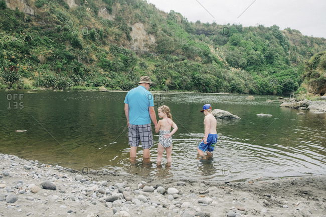 Family playing in the water at a scenic river spot