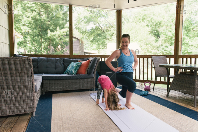 Mother and daughter laughing and working out in fitness routine