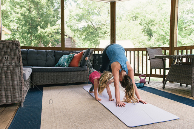 Mother and daughter workout and yoga  together from home