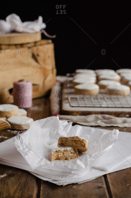 Freshly baked Polvorones placed on wrapping paper on wooden table for Christmas holidays