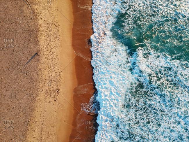 Sand beach aerial, top view of a beautiful sandy beach aerial shot