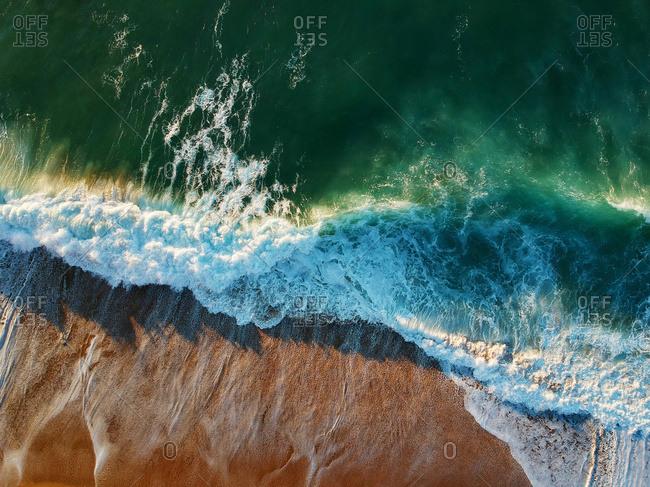 Sand beach aerial, top view of a beautiful sandy beach aerial