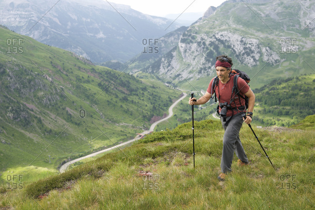Hiker in Canfranc Valley, Pyrenees in Spain.