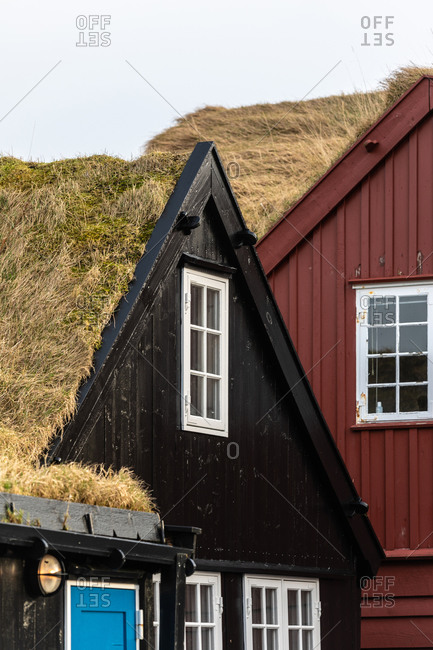 Exterior of wooden residential house in settlement in autumn on Faroe Islands