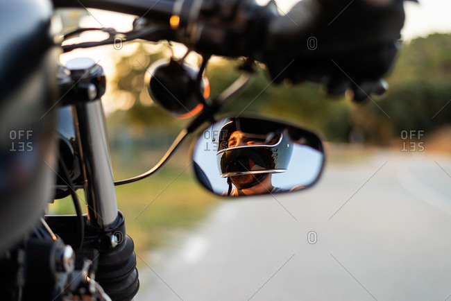 Man in the Side View Mirror of a motorbike