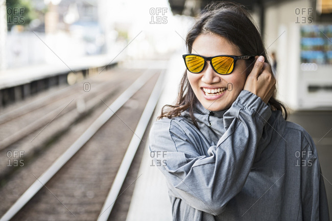 Woman waiting for a train at train station in Osaka