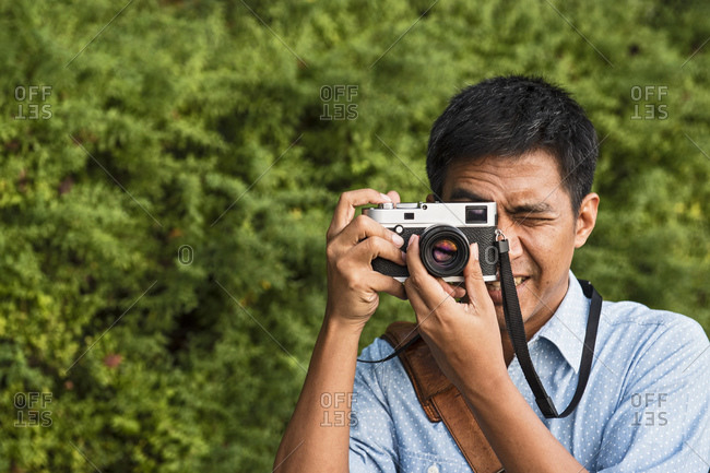 Man taking a picture with a classic range finder camera