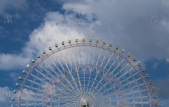 Ferris wheel against blue sky in Osaka / Japan