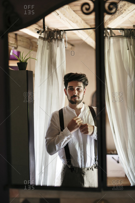 Groom getting ready for wedding at dressing room